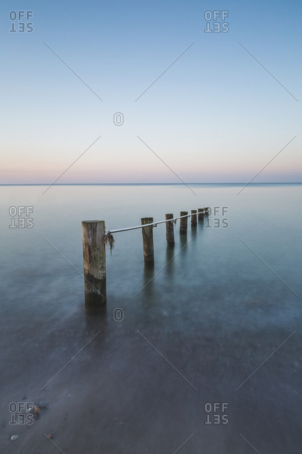 Germany- Mecklenburg-Western Pomerania- Baltic Sea- breakwater- beach in the evening