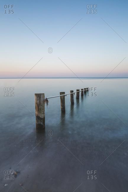 Germany- Mecklenburg-Western Pomerania- Baltic Sea- breakwater- beach in the evening