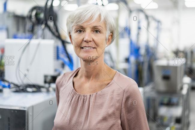 Portrait of confident senior woman in a factory