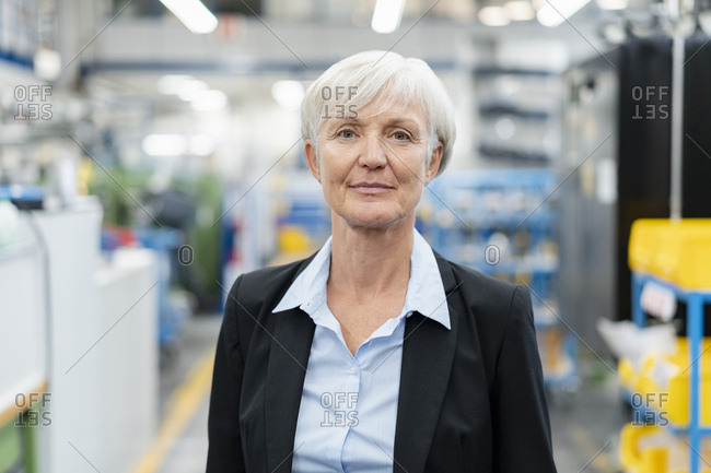 Portrait of confident senior businesswoman in a factory