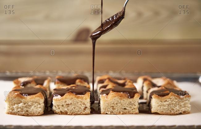 Garnishing homemade cake with chocolate
