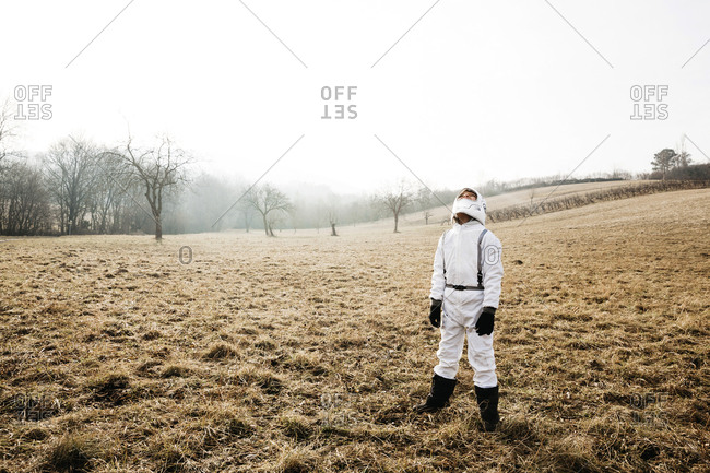 Boy wearing white space suit