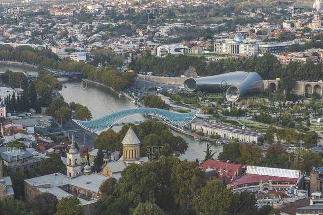 October 14, 2018: Georgia- Tbilisi- view from fortress Narikala on old town with Bridge of Peace- concert hall and parliament