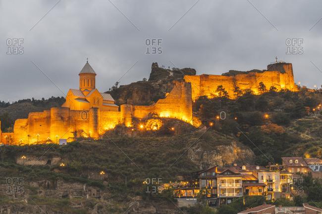 Georgia- Tbilisi- view on fortress Narikala at dusk