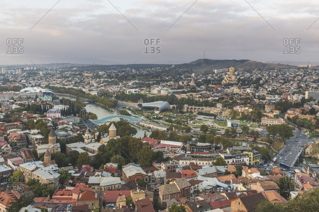 October 14, 2018: Georgia- Tbilisi- view from fortress Narikala on old town with Bridge of Peace- concert hall- parliament and Sameba cathedral