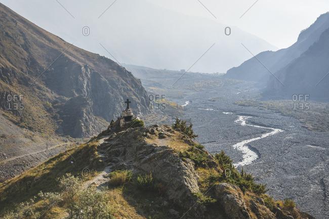 Georgia- Greater Caucasus- Stepantsminda- wayside cross at Georgian Military Road