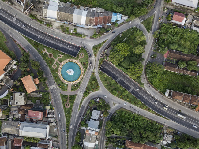 Indonesia- Bali- Denpasar- Aerial view of Patung Dewa Ruci statue at crossroads