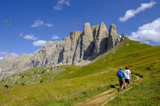 Italy- South Tyrol- Sella group- hikers walking up Passo di Sella