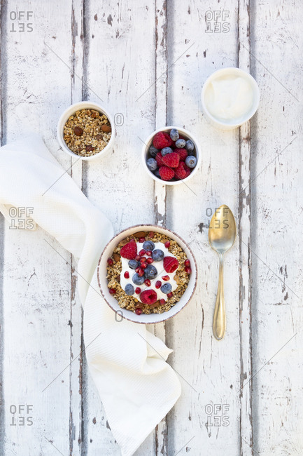 Bowl of muesli with Greek yogurt- popped quinoa- raspberries- blueberries and pomegranate seed