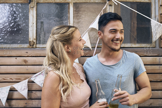 Friends having fun at a barbecue party- drinking beer