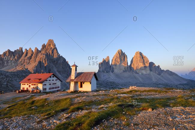 July 22, 2015: Chapel and Refugio Antonio Locatelli  with the famous Tre Cime di Lavaredo and Mount Paterno at sunrise- Trentino-Alto Adige- Italy