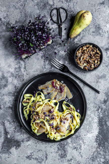 Tagliatelle with pear gorgonzola sauce- walnuts and red cress