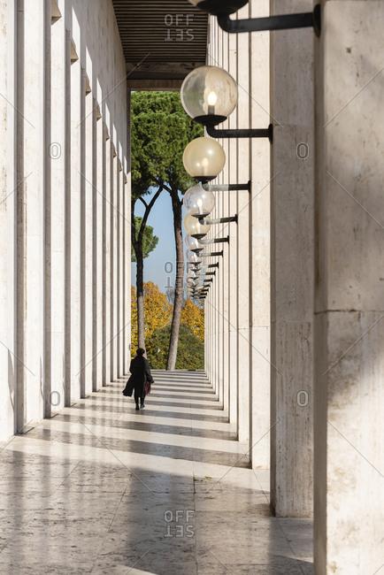 Back view of a woman walking through Palazzo Ufficici