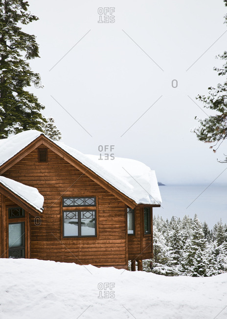 Snowy cabins in the mountains