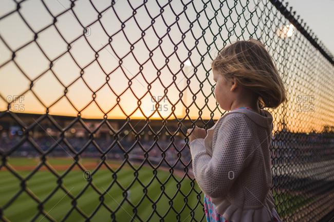 Girl at a baseball game