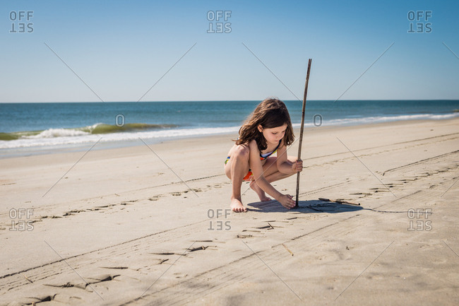 Girl digging in the sand