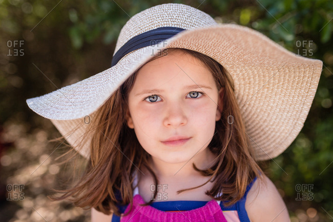 Portrait of a girl wearing a sun hat