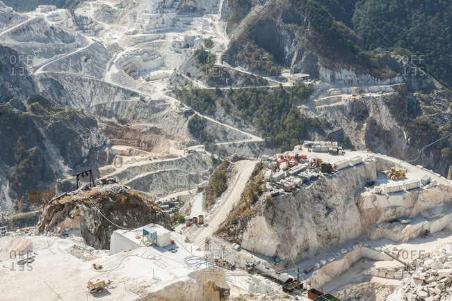 August 20, 2012: Italy, Tuscany, Carrara . marble quarry near Colonnata. The quarries provide raw material for various production chains: pure marble for construction, debris and marble dust for road construction, chemical industry, cosmetics