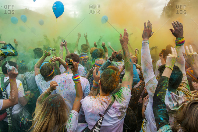 "May 23, 2015: Italy, Tuscany, Florence . The Color Run is a non-competitive race, conceived as a recreational and socializing event inspired by the oldest Indian ""Holi Festival"" where pilgrims take part in the ceremonies and cover themselves with colored rice powder. The Color Run has become an international event present in thirty countries around the world"