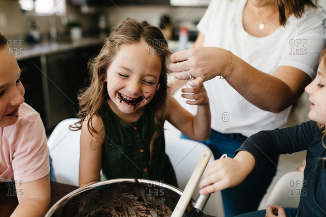 Kids mixing brownies and baking and getting messy