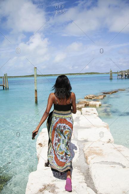 October 27, 2011: EXUMA, Bahamas. A local women along the shore of Staniel Cay.