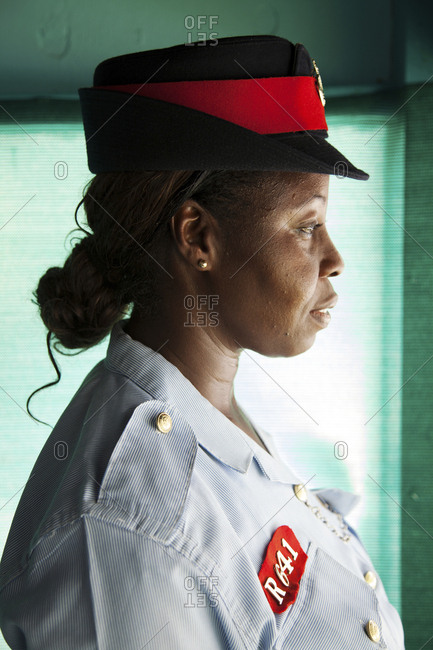 October 27, 2011: EXUMA, Bahamas. A local police woman at the Staniel Cay Yacht Club at Staniel Cay.