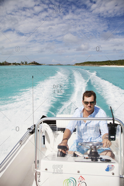 October 27, 2011: EXUMA, Bahamas. Grant, one of the managers at the Fowl Cay Resort taking the resort speedboat for a ride.