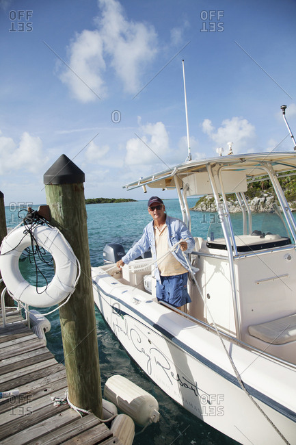 October 28, 2011: EXUMA, Bahamas. Yves, the Fowl Cay Resort manager getting the boat ready for an excursion.