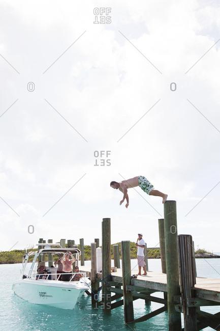 October 28, 2011: EXUMA, Bahamas. Jumping into the water at the Compass Cay Marina.