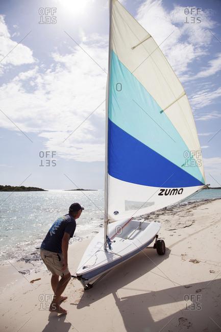 October 29, 2011: EXUMA, Bahamas. Yves, the Resort Manager, going sailing at the Fowl Cay Resort.