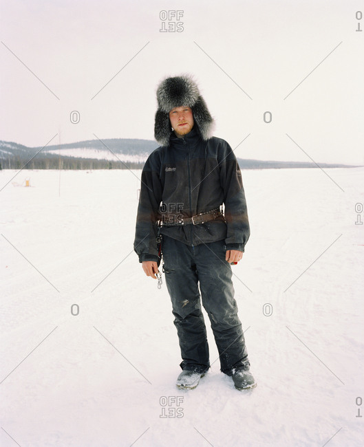 October 4, 2010: FINLAND, Artic, Nunnanen, portrait of a mid adult man standing. He is a husky driver.