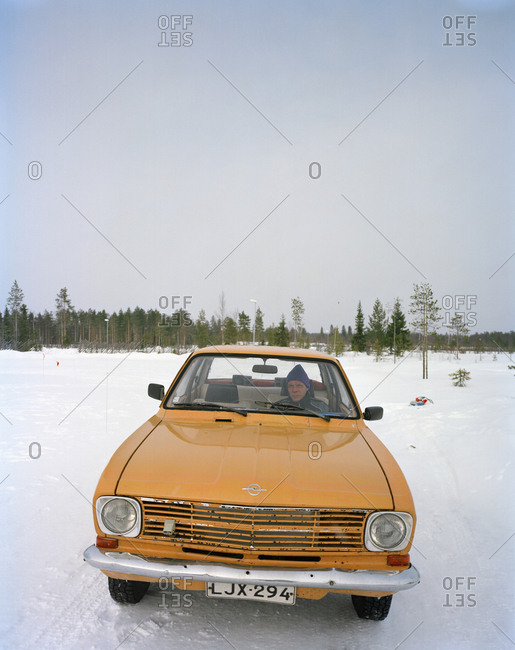 October 4, 2010: FINLAND, Rovaniemi, man sitting in a vintage car