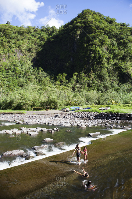 April 6, 2010: FRENCH POLYNESIA, Tahiti. A local swimming hole close to the town of Papenoo along a dirt road towards the center of the island. Favored by local families and kids.