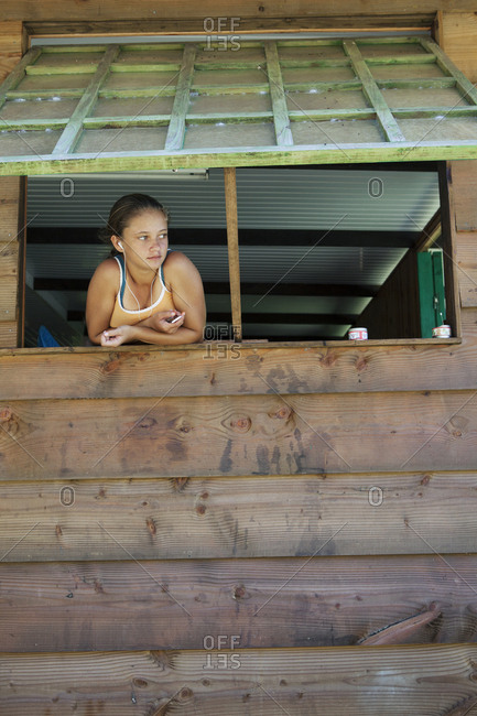 April 8, 2010: FRENCH POLYNESIA, Tahaa Island. Isabelle Hansen listening to music at her home.