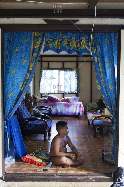 April 9, 2010: FRENCH POLYNESIA, Tahaa. A young boy watching Television in his home.