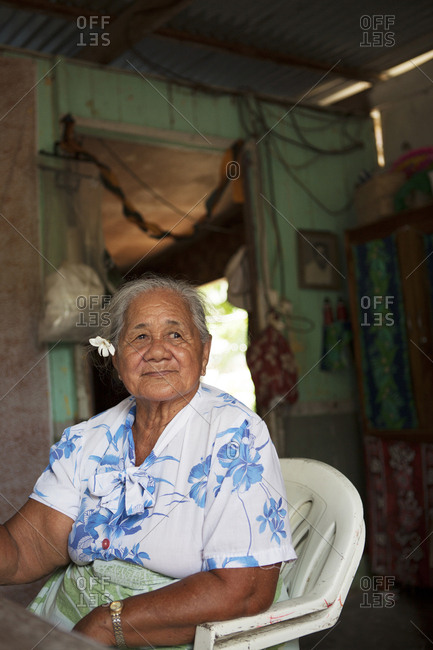 April 9, 2010: FRENCH POLYNESIA, Tahaa Island. A grandmother sitting in her kitchen.