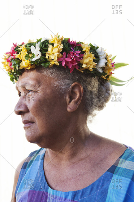 April 10, 2010: FRENCH POLYNESIA, Tahaa Island. A portrait of a woman wearing flowers in her hair in Tahaa Island.