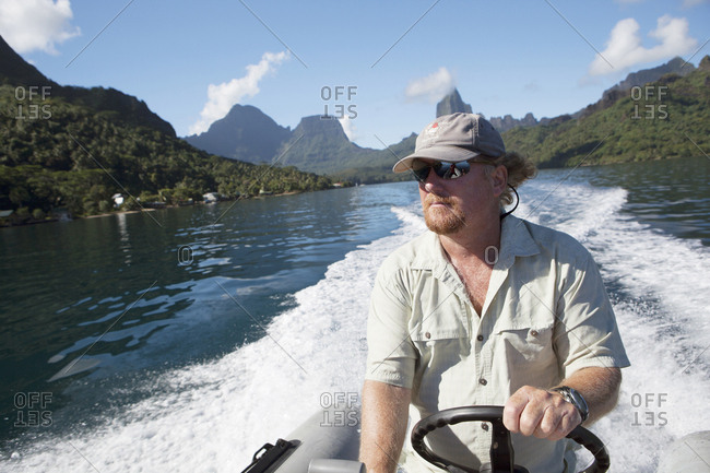 April 11, 2010: FRENCH POLYNESIA, Moorea Island. FRENCH POLYNESIA, Moorea Island. A boat ride with view of Opunohu Bay in the background.