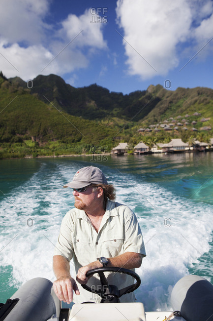 April 11, 2010: FRENCH POLYNESIA, Moorea. A boat ride with the Intercontinental Moorea Resort and Spa in the background.
