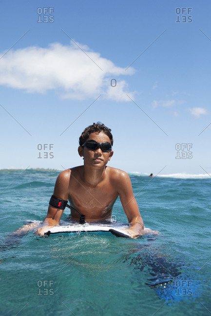 April 11, 2010: FRENCH POLYNESIA, Moorea. Temakehu, local surfer, boogey boarding.