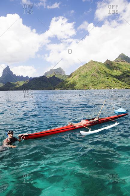 April 11, 2010: FRENCH POLYNESIA, Moorea Island. Spearfisherman at Opunohu Bay.