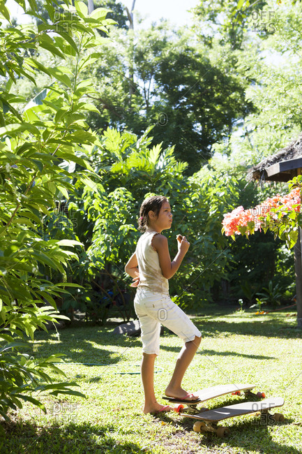 April 14, 2010: FRENCH POLYNESIA, Moorea. Fiona at her family owned Te Nunoa Private Garden Bungalow.