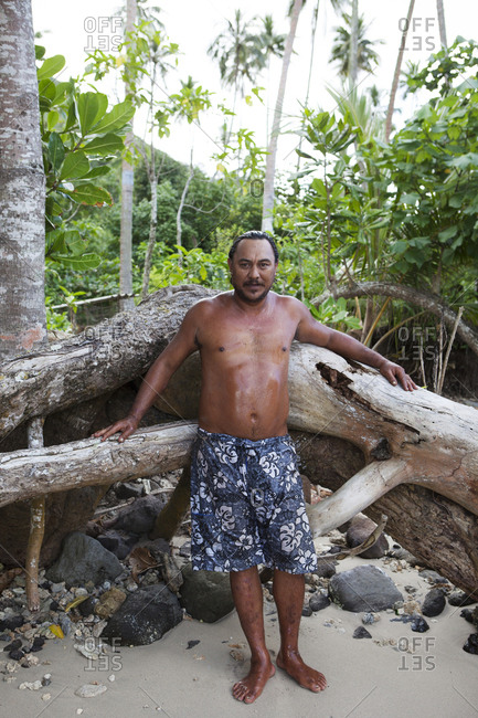 April 14, 2010: FRENCH POLYNESIA, Moorea. Portrait of man after swimming in the ocean.