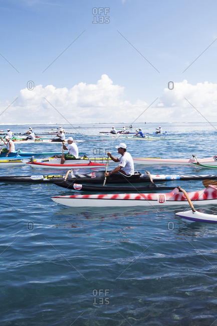 April 17, 2010: FRENCH POLYNESIA, Tahiti. The Aranui TNTV Race. Participants and spectators line up the beach. A race involving Stand Up Paddle boards and Outrigger Canoes.