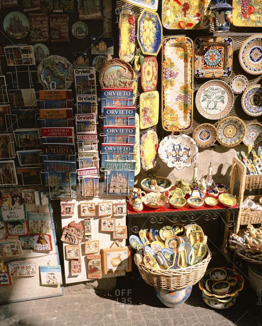 February 16, 2010: ITALY, Orvieto, Umbria, plates and maps displayed in abundance for sale.