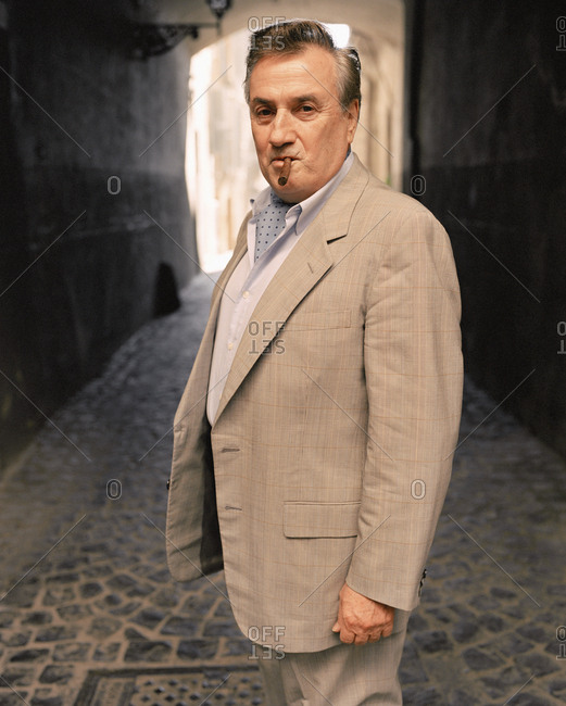 February 16, 2010: ITALY, Orvieto, Umbria, portrait of Giancarlo Parreti with cigar.