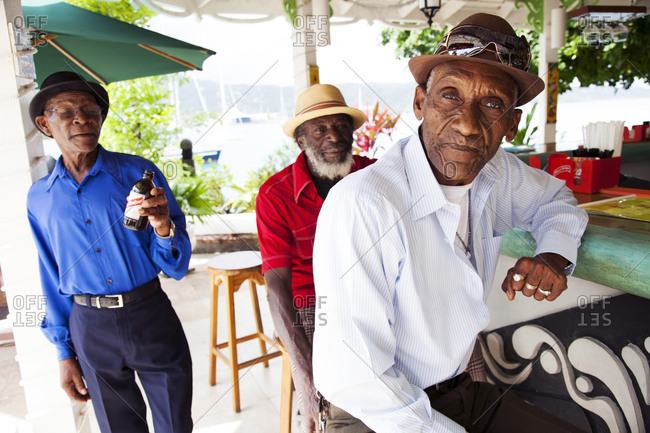 January 31, 2012: JAMAICA, Port Antonio. The Jolly Boys, a Mento band, having drinks at Marybelle's Pub on the Pier.