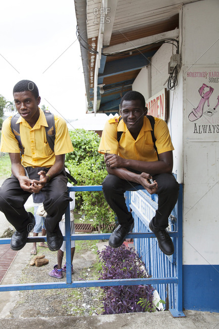 January 31, 2012: JAMAICA, Port Antonio. Students in front of a school in the downtown area.