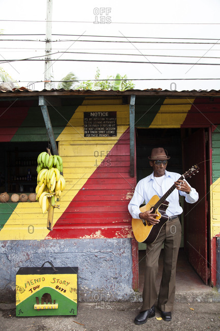 January 31, 2012: JAMAICA, Port Antonio. Albert Minott of the Mento band, The Jolly Boys playing guitar at the Willow Wind Bar.
