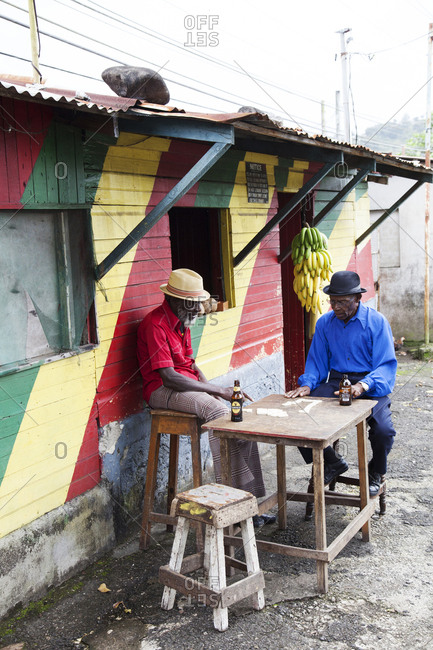 "January 31, 2012: JAMAICA, Port Antonio. Joseph ""Powder"" Bennett and Derrick ""Johnny"" Henry of the Mento band, The Jolly Boys playing dominoes at the Willow Wind Bar."